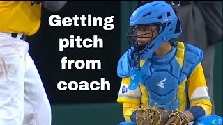 Coach giving pitch signs to catcher. FAST and effective.
