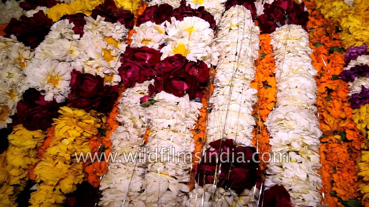 Vendors sell flower garlands for temple offerings in delhi youtube izmirmasajfo Gallery