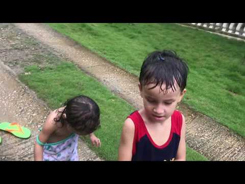 Josephyn in Muddy Puddles - Fil-am Girl playing in the Rain and Puddles - Simple life Philippines