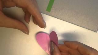 Аппликация Объёмный цветок из сердечек(http://ostrovdetok.ru/app14.shtml видео урок как сделать аппликацию из бумаги