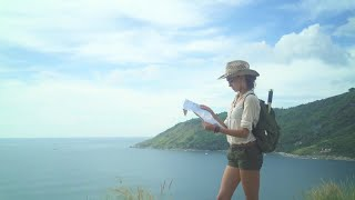 Hiker Consults Island Map Stock Video