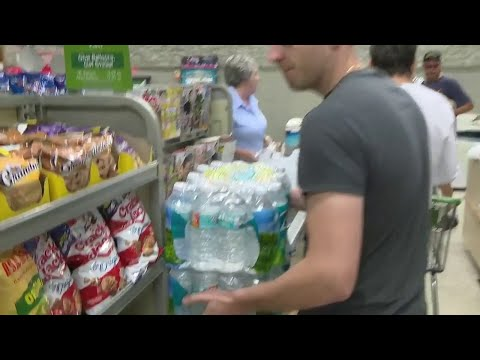 People flock to stores to stock up on supplies ahead of Hurricane Dorian