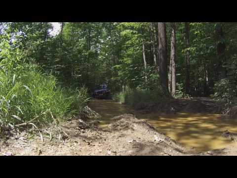Jeep TJ Jeff Pierce Pitbull Rockers plowing through thick muddy hole