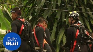 Thai rescue teams search for secret passage out of flooded cave - Daily Mail