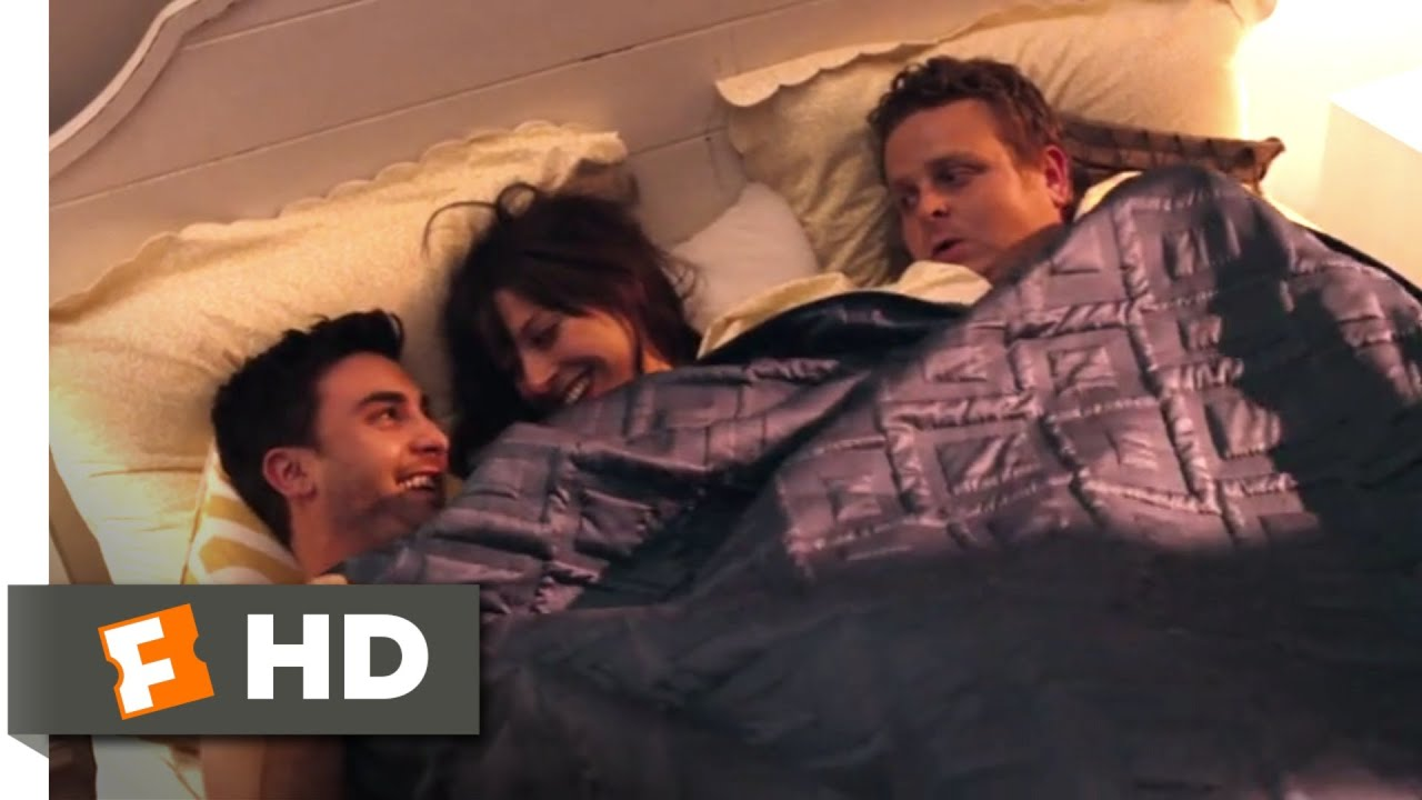 Threesome act on a bed