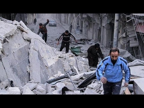 UN evacuates civilians from Homs but Syrian fighting continues