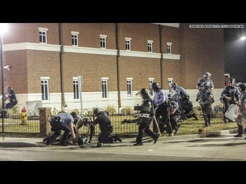 Two cops shot in Ferguson after chief resigns