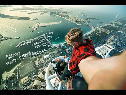 Russian guys on the roof top in Dubai. Princess Tower .414 m (1,356 ft)