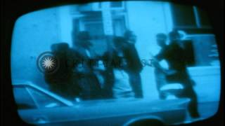 Television screen shows police patrolling the streets after the riots in Washingt...HD Stock Footage