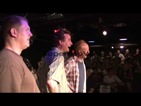 Ian Roberts, Matt Besser and Matt Walsh listen to audienc...
