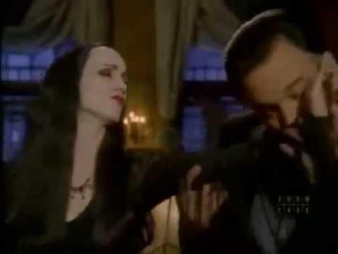 Addams family gomez kissing morticias arm