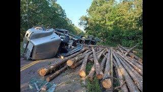 rock-roll-over-log-truck