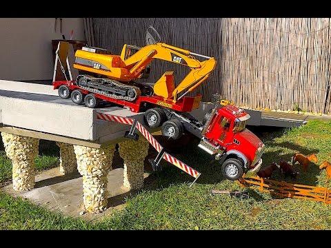 BRUDER TRUCK Mack and CAT Excavator crash in Bridge!