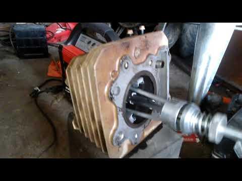Honda fourtrax new rings n cylinder work - YouTube