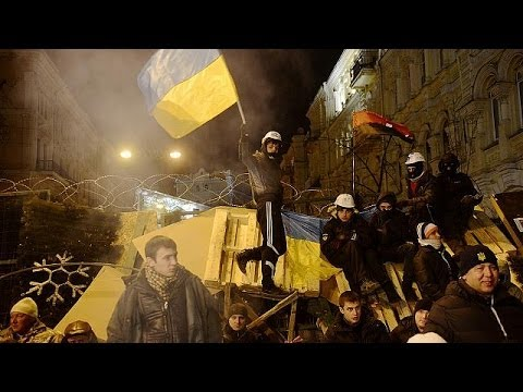 Ukraine's government maintains bitter standoff with protesters over European U-turn