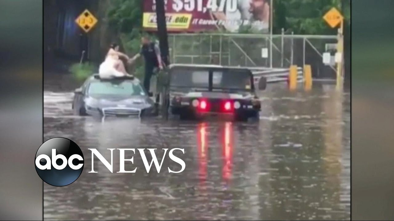 Bride, groom rescued from flooded car