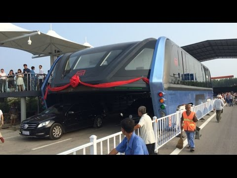 China's futuristic bus that drives above car traffic is finally here