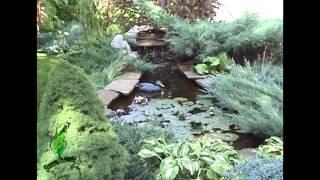 Красивый искусственный водоем с гротом от
