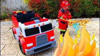 Father and son unbox and assemble Fire Truck Power Wheel