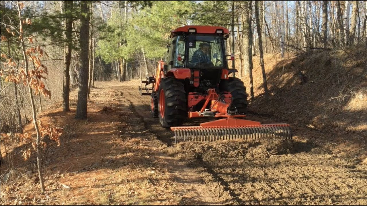 Demonstration of grading out driveway ruts with a Landscape Rake