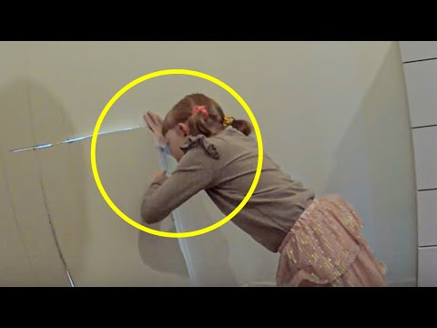 Girl Discovers a Secret Door in Her Bedroom And Opens It As Her Father Looks On in Tears