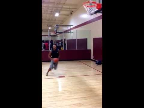 """Long Jump World Record Holder Mike Powell at 6' 2"""" celebrates his 50th birthday with a dunk."""