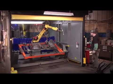 Rite-Hite Machine Guarding - Defender Automated Barrier Door Outperforms Light Curtains