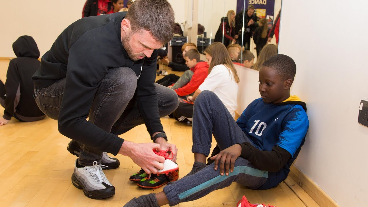 490c3007f Carrick s Boot Room donates football boots at Street Reds! - YouTube