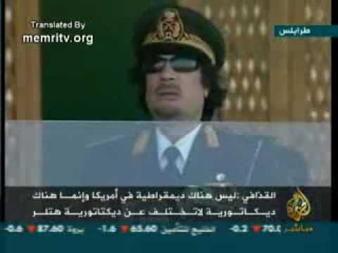 Momar Kadafi Supports Obama