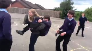 Girl giving guy a piggy back challenge