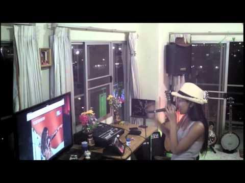 Thai gal having fun singing Karaoke
