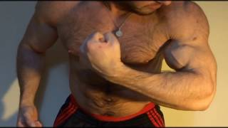Hairy muscle hunk flexing muscle