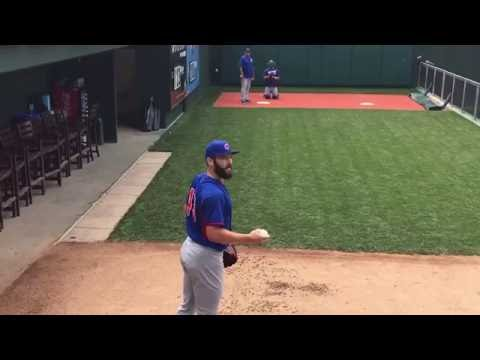 Jake Arrieta calls out a heckler during a bullpen session