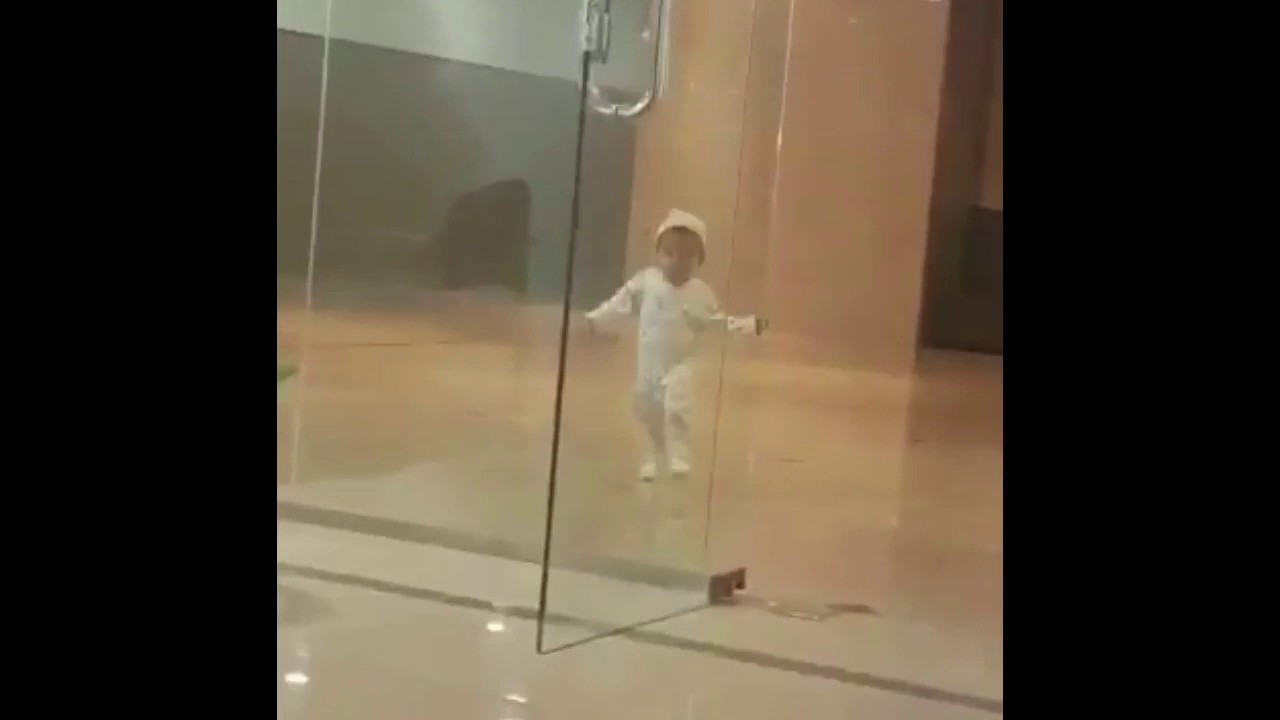 Arabic Kid walks into glass