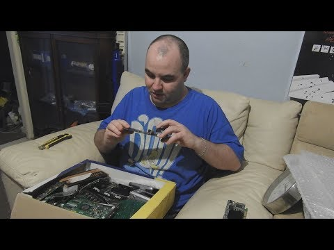 Unboxing A Donated Package of CPUs, GPUs, Logic Boards, and Memory