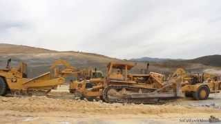 cat d9g ripping for herd of 657e s