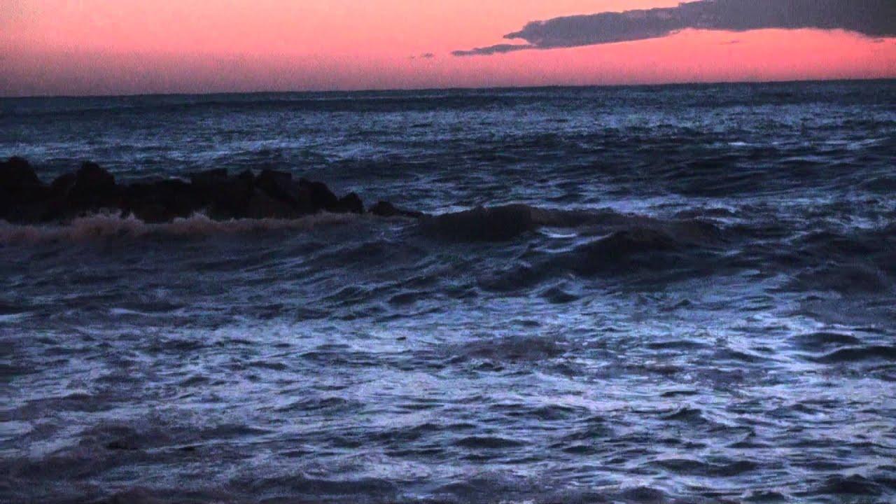 Il mare mosso al tramonto - YouTube