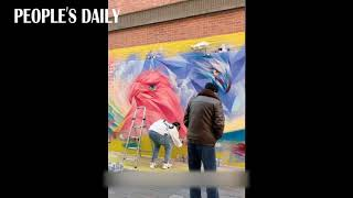 Young artist goes viral for spray painting 10-meter-long pastel-colored dragon in #Shanghai