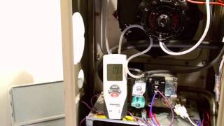 Troubleshoot the pressure switch on the 80% AFUE gas furnace