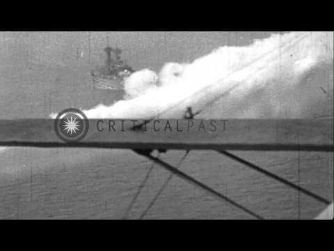 United States Navy aircraft lay smoke screen around ships in United States. HD Stock Footage