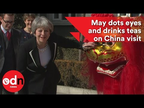 May dots eyes and drinks teas on China visit
