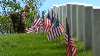 Soldiers Place Flags at Arlington National Cemetery Graves