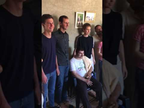 president-assad-visiting-the-family-of-a-wounded-soldier-in-hama-along-with-his-wife-and-3-kids