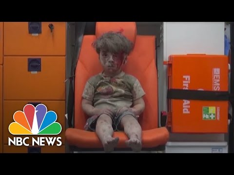 Boy Rescued From Rubble After Airstrike In Aleppo | NBC News