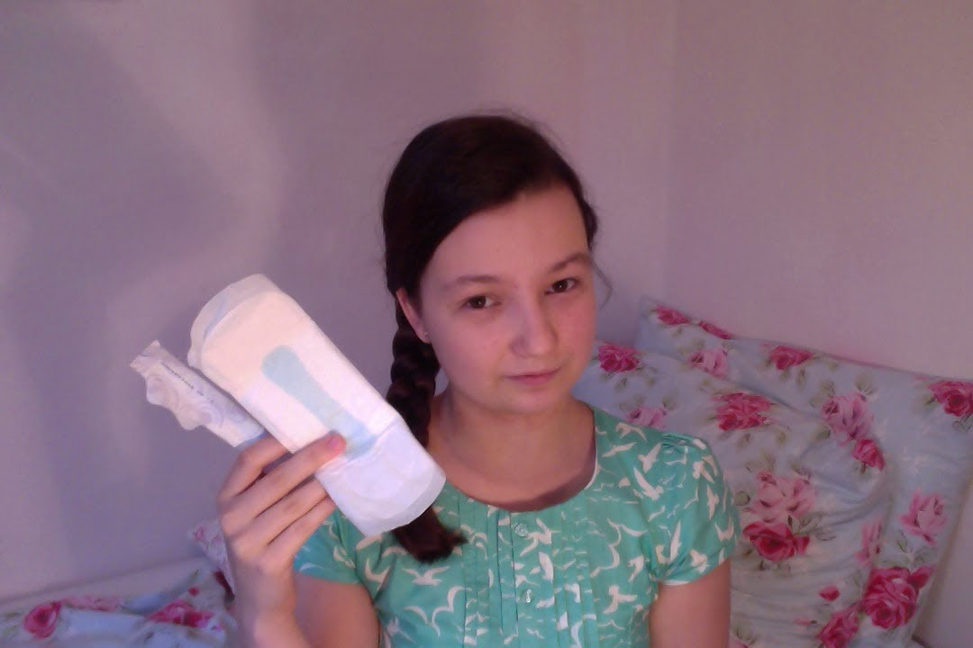 Pity, that Girl in putting bloody tampon pad