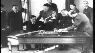 Ribbentrop and a Japanese delegate sign the Japanese German economic pact in Germ...HD Stock Footage