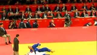 Russian President Vladimir Putin, British Prime Minister David Cameron watch Olympic Judo