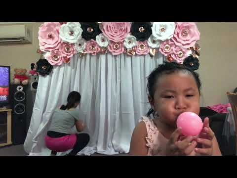 DIY Paper Flower Backdrop with string fairy curtain lights and Spiral Balloon Column
