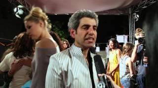 في مقابلة حصرية من أسبوع الموضة العربي- المصمم الفلسطيني الإيطالي جمال تسلاق يكشف لماذا اختار اللون الأبيض وما قصة فستان عرس الجدة؟