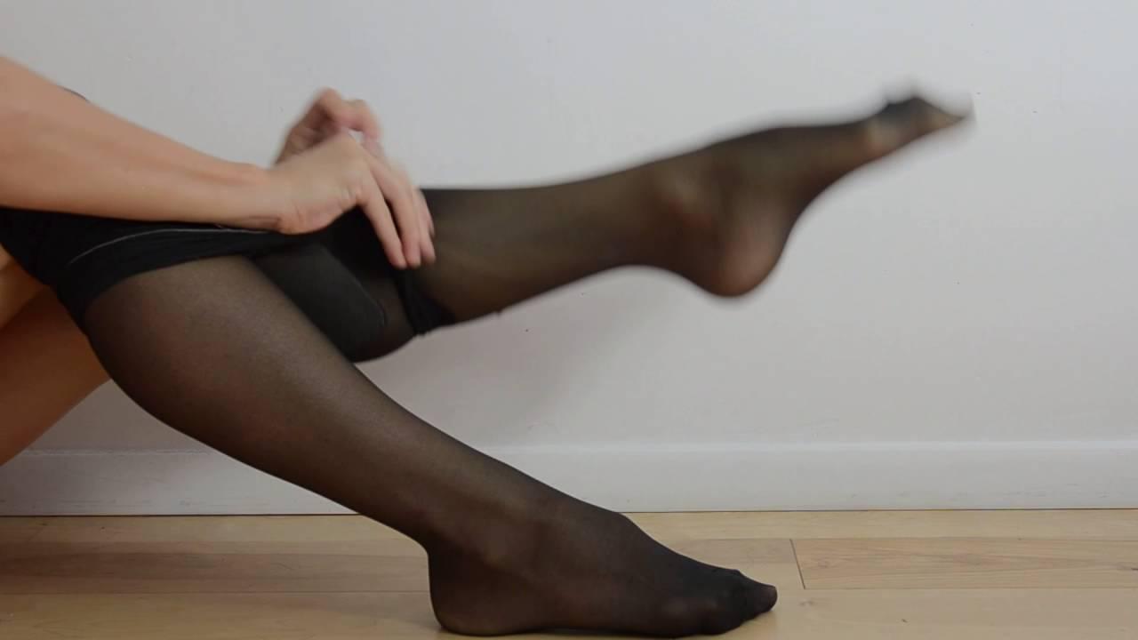 in stockings feet
